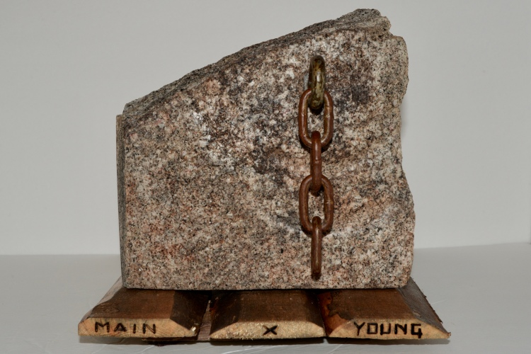 Granite and chain section on wood base